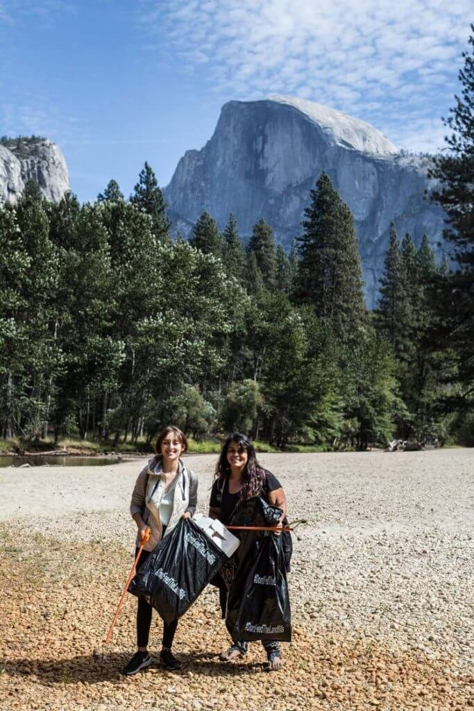 Yosemite Facelift volunteers picking up trash with Half Dome in the background