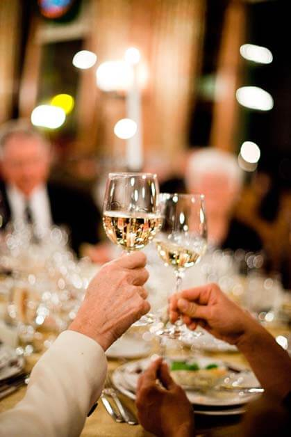 White wine toast at The Ahwahnee's Signature Event, Vintners' Holidays