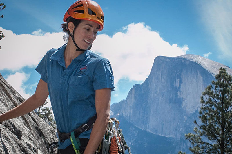 Climber with Half Dome in the background.