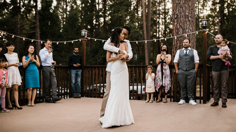 Wedding couple dancing at a vacation rental cabin