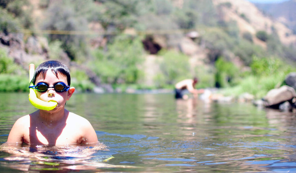 Boy swimming in the merced river