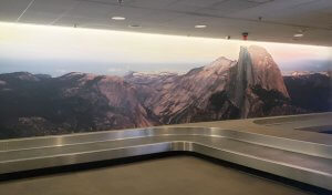 Baggage claim with Half Dome mural