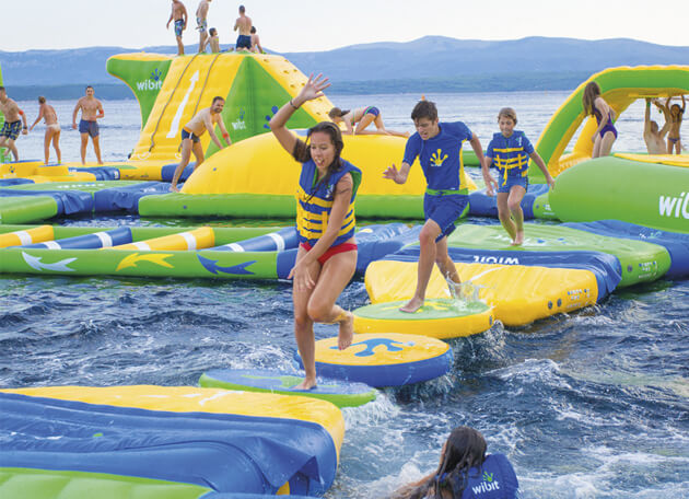 kids playing at the aqua park on lake mcclure