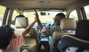 road trip high-fives in the car