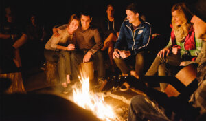 Group meeting around the campfire at The Yosemite Bug Rustic Mountain Resort.
